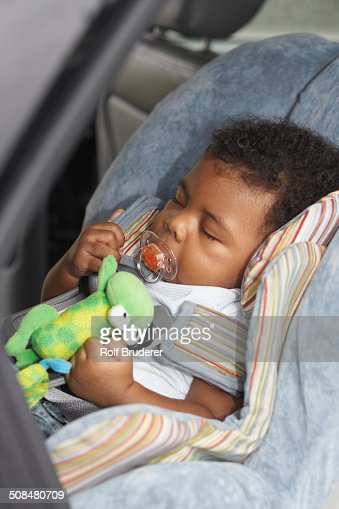 Black Baby Sleeping In Car Seat Stock Photo | Getty Images