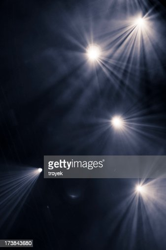 Black background with five scattered spotlights