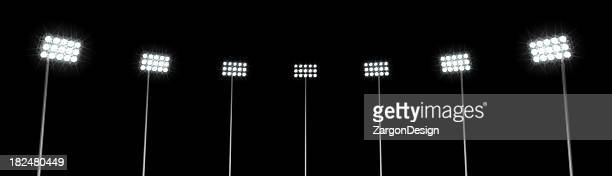 A black background with seven stadium lights