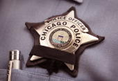 A black band is stretched across a District 1 Chicago Police officer's badge to mourn the death of a fellow officer on July 19 2010 in Chicago...