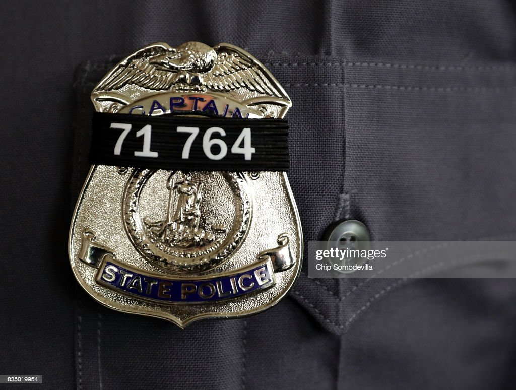 A black band with the badge number of Virginia State Police Trooper-Pilot Berke M.M. Bates is worn on the badges of fellow troopers during his funeral at Saint Paul's Baptist Church August 18, 2017 in Richmond, Virginia. Bates and Lieutenant Pilot Jay Cullen were killed when their Bell 407 helicopter crashed into a wooded area while they were monitoring the civil unrest during the white supremacy 'Unite the Right' rally August 12 in Charlottesville, VA.