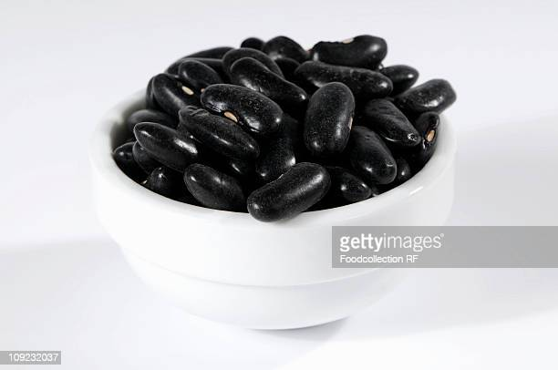 Black beans in ceramic bowl, close-up