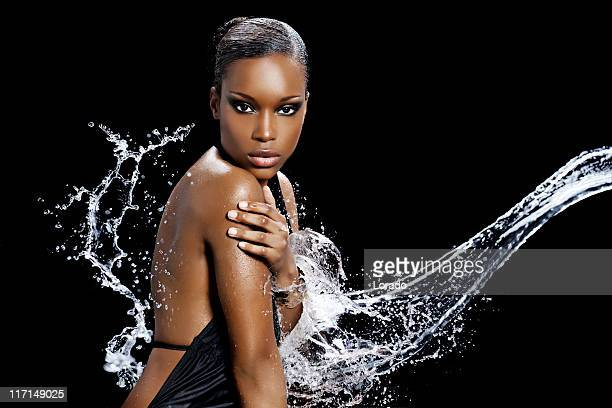 black beauty enjoying water splash
