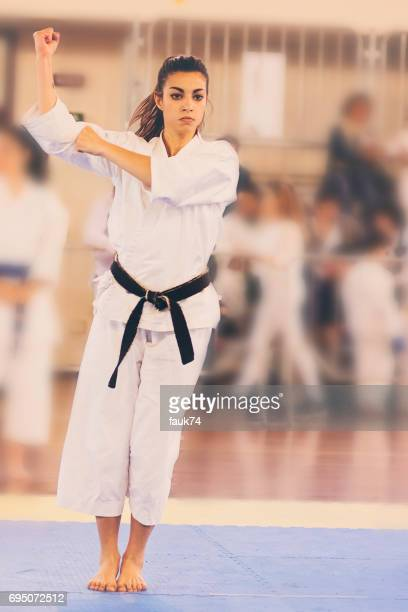 Black Belt 20Y Girl Performing Karate at a Competition