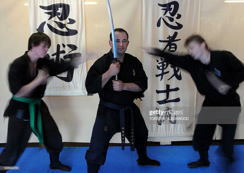 Black belt ninjutsu instructor Kaylan Soto (C) trains ninjas in combat techniques at the Ninja Senshi Ryu (Ninja Warrior School) near Sydney on May 20, 2010. Kaylan and his black-clad students have become local heroes after they saved a 27-year-old German medical student from three Australian muggers who struck outside their martial arts school. AFP PHOTO/Torsten BLACKWOOD