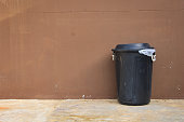 black bin and wall on the road