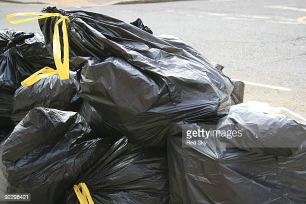 Black bin liners on street