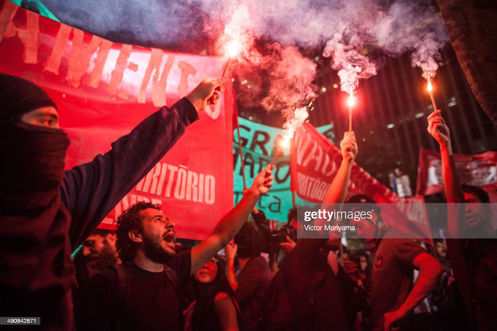 Black Bloc protesters Group clash with policemen during a protest against the World Cup on the evening of Thursday, May 15, 2014 in Sao Paulo, Brazil. Protests are taking place in various cities of the country and questioned the high spending on construction of stadiums and fight for better conditions and budget for health and education.
