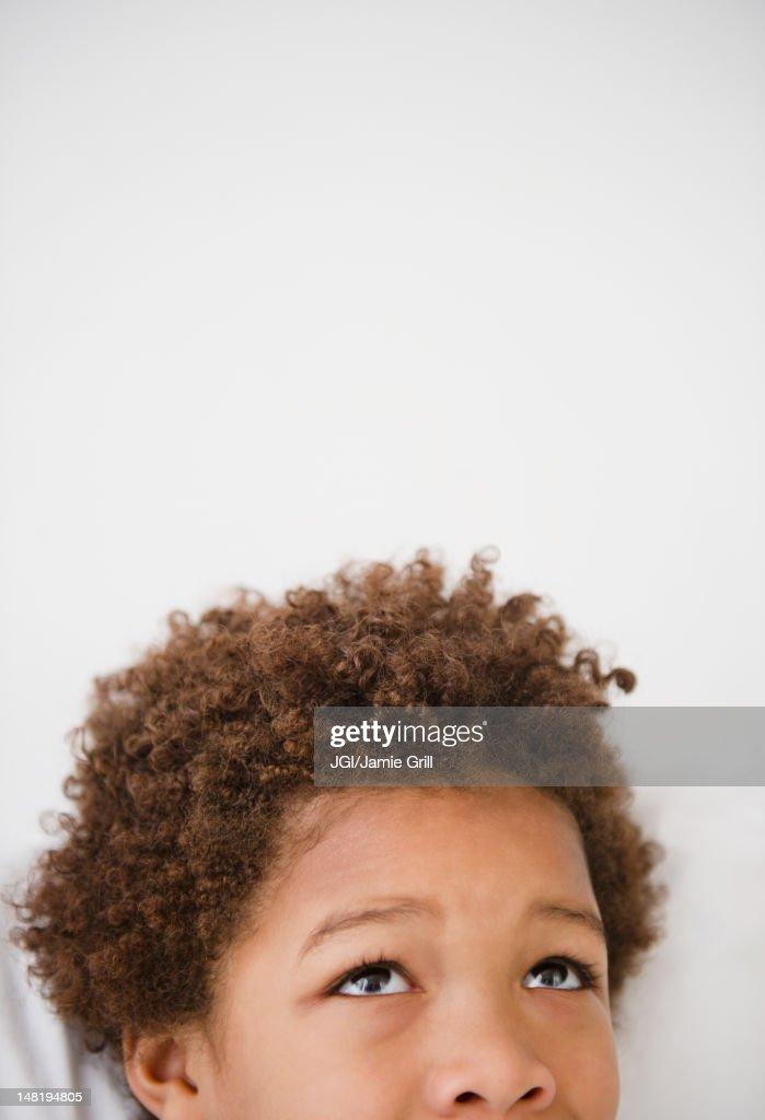 Black boy looking up,  : Stock Photo