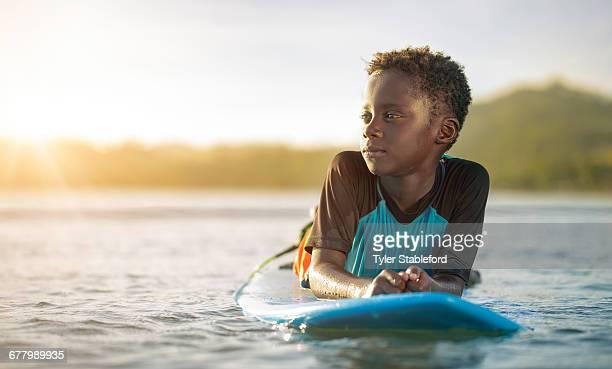 Black boy on surfboard
