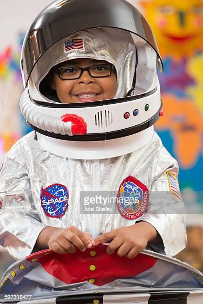 Black boy wearing astronaut costume