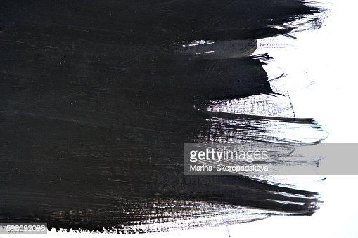 black brush strokes on white paper : Stock Photo