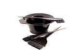 Black brushes put in bowl for hair dye on white background. Isolated.