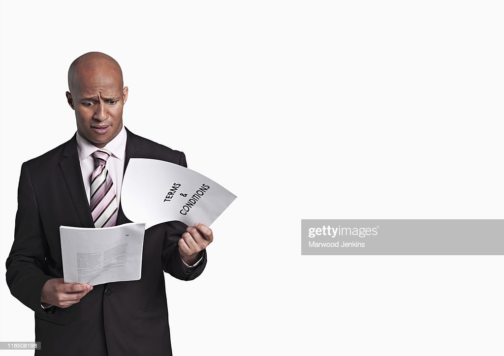 Black business man reading Terms and Conditions
