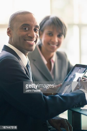 Black business people using tablet computer : Stock Photo