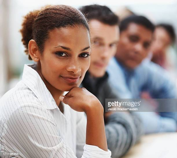 Black business woman in conference with associates