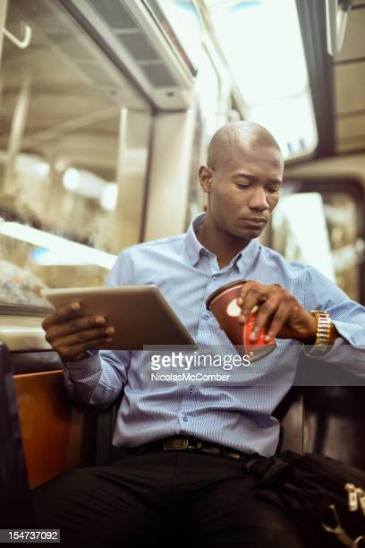 Black businessman checking time in subway