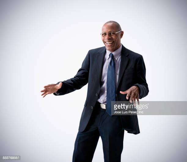 Black businessman dancing