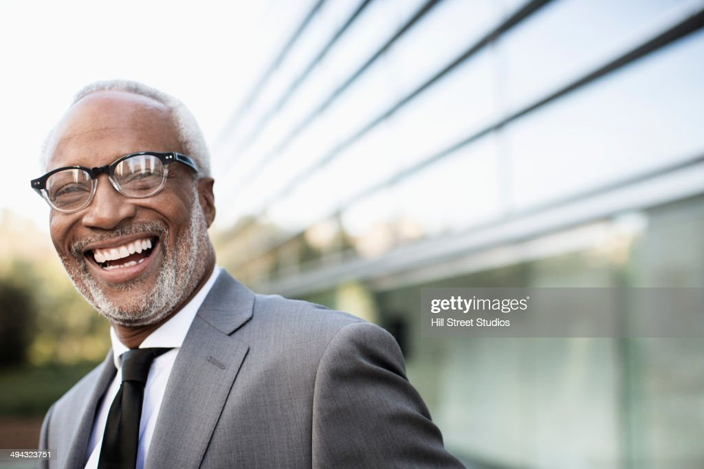Black businessman laughing outdoors