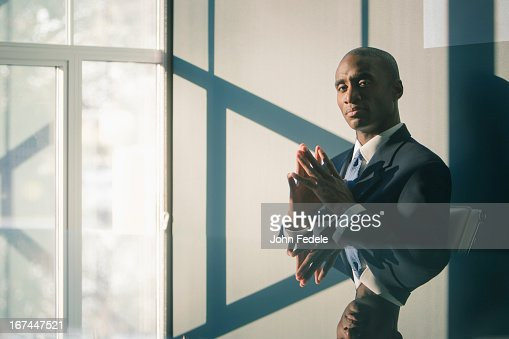 Black businessman sitting at desk : Stock Photo