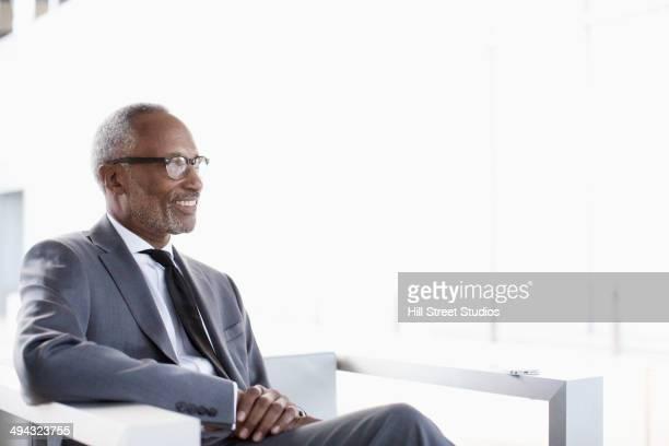Black businessman sitting in lobby area