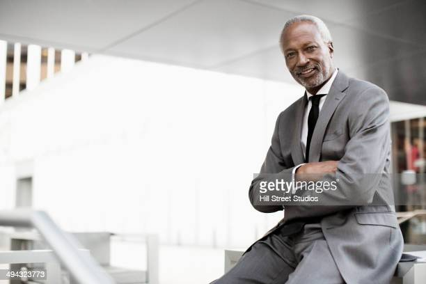 Black businessman sitting outdoors