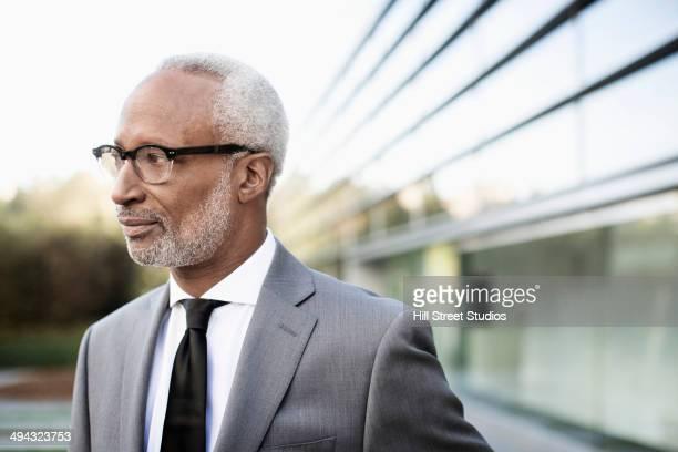 Black businessman standing outdoors