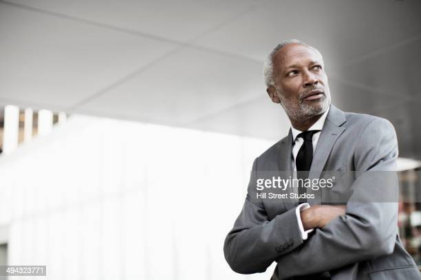 Black businessman standing with arms crossed