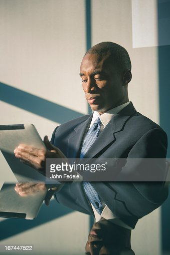 Black businessman using tablet computer : Stock Photo