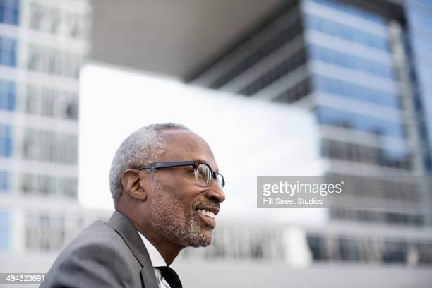 Black businessman walking on city street