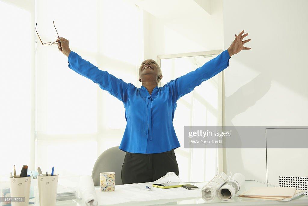 Black businesswoman cheering : Stock Photo