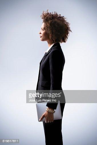 Black businesswoman holding digital tablet
