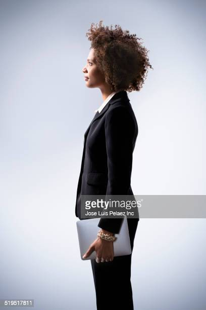 Black businesswoman holding digital tablet