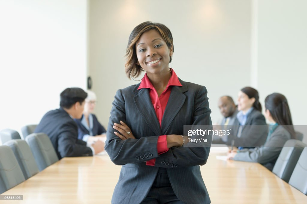 Black businesswoman in conference room with co-workers : Stock Photo