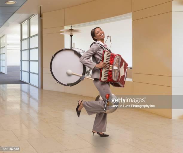 Black businesswoman one-man-band
