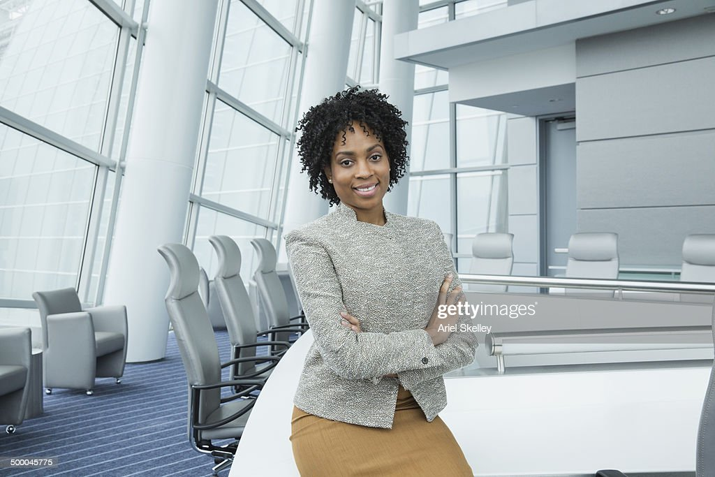 Black businesswoman standing in conference room