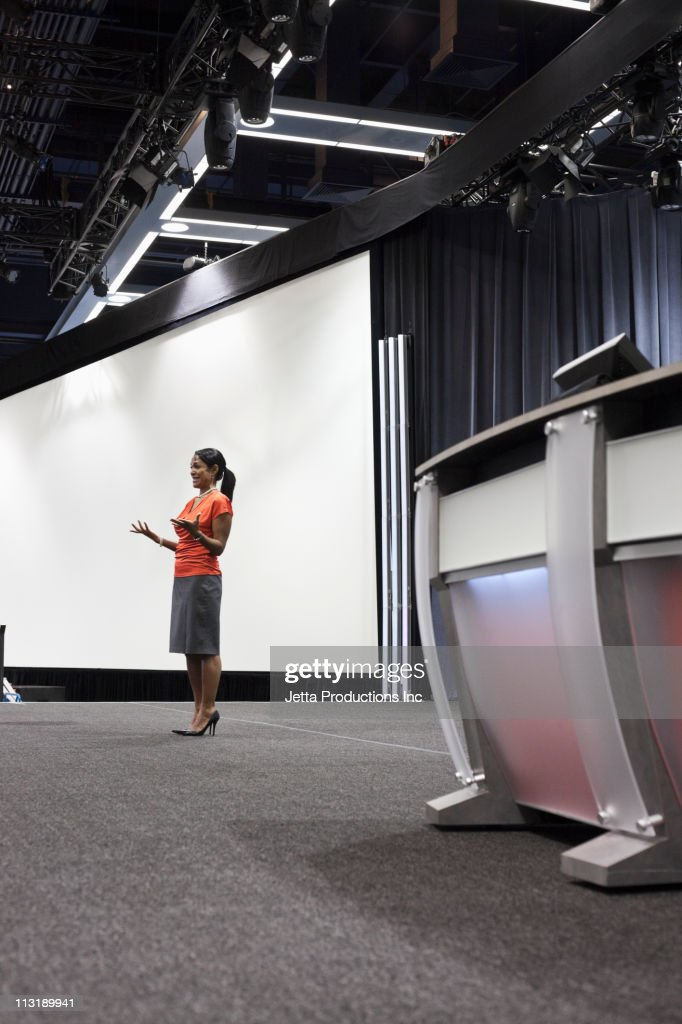 Black businesswoman standing on stage