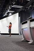 Black businesswoman standing on stage