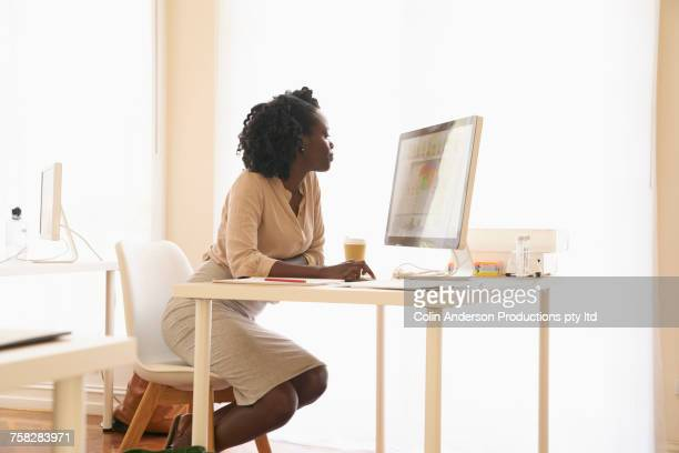 Black businesswoman using computer
