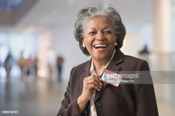 Black businesswoman wearing name tag