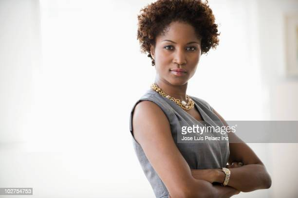 Black businesswoman with arms crossed