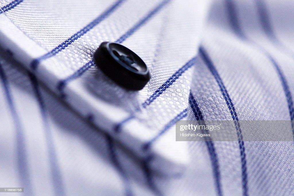 Black button on shirt : Stock Photo