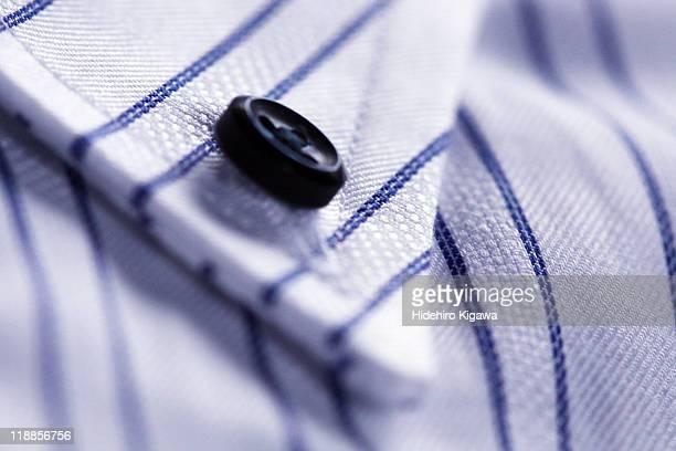 Black button on shirt