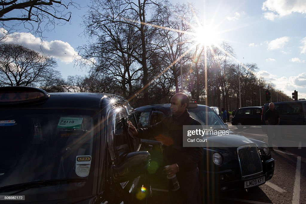 A black cab driver cleans his taxi as he takes part in a strike to protest against Uber on February 10, 2016 in London, England. Drivers are claiming that Uber is not subjected to the same stringent regulation requirements as they are and that deregulation of the trade has compromised passenger safety.