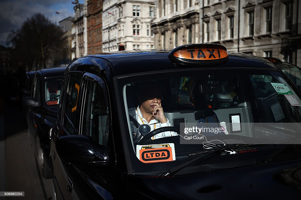 A black cab driver takes part in a strike to protest against Uber on February 10, 2016 in London, England. Drivers are claiming that Uber is not subjected to the same stringent regulation requirements as they are and that deregulation of the trade has compromised passenger safety.