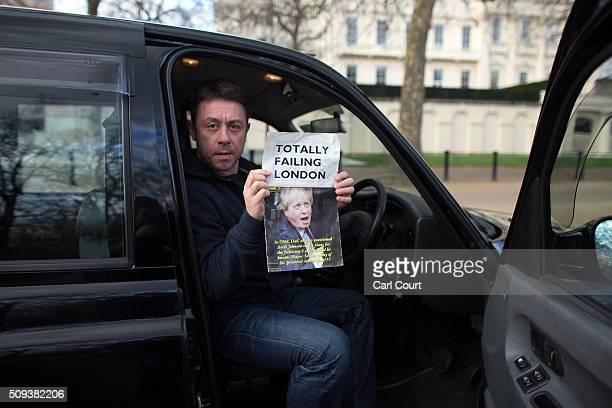 A black cab driver takes part in a strike to protest against Uber on February 10 2016 in London England Drivers are claiming that Uber is not...