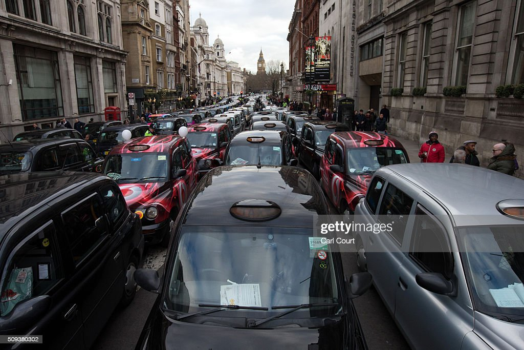 Black cab drivers block Whitehall as they take part in a protest against Uber on February 10, 2016 in London, England. Drivers are claiming that Uber is not subjected to the same stringent regulation requirements as they are and that deregulation of the trade has compromised passenger safety.