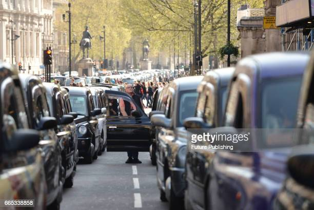 Black cab drivers protest against Uber and bring the city to a standstill on April 06 2017 in Westminster England PHOTOGRAPH BY Matthew Chattle /...