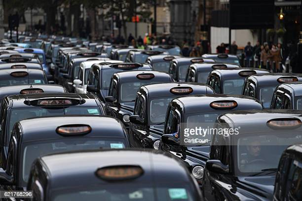 Black Cab drivers take part in a protest to highlight congestion and air pollution on November 8 2016 in London England Drivers are claiming that...