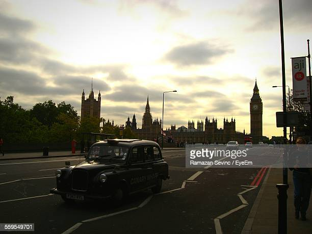 Black Cab In Front Of Big Ben Against Cloudy Sky During Dusk